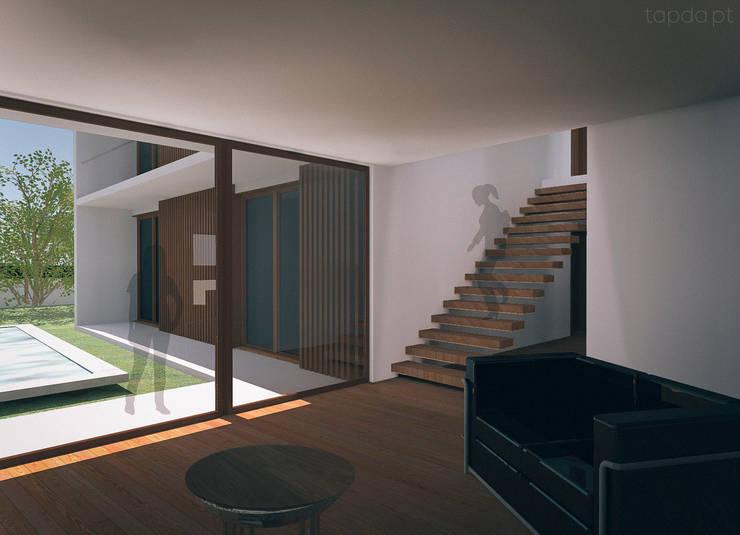 Casa na Charneca da Caparica: Salas de estar  por Tapada arquitectos