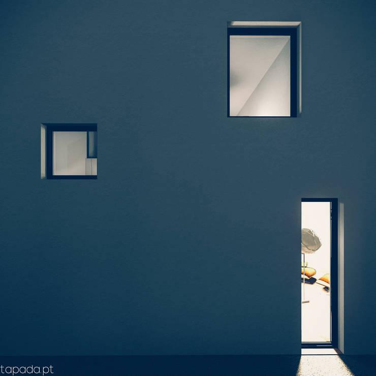 Casa em Fernão Ferro: Casas  por Tapada arquitectos