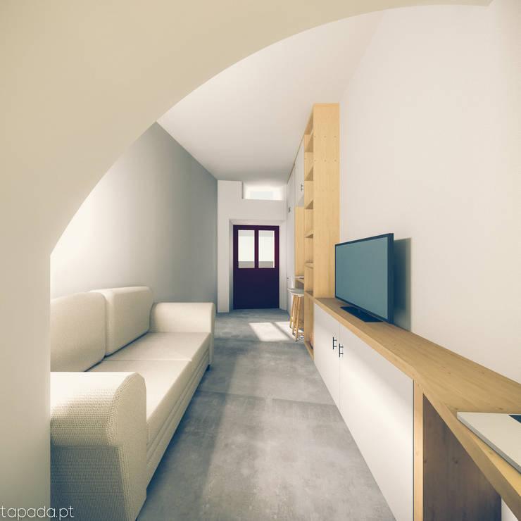Recuperação em Évora: Salas de estar  por Tapada arquitectos