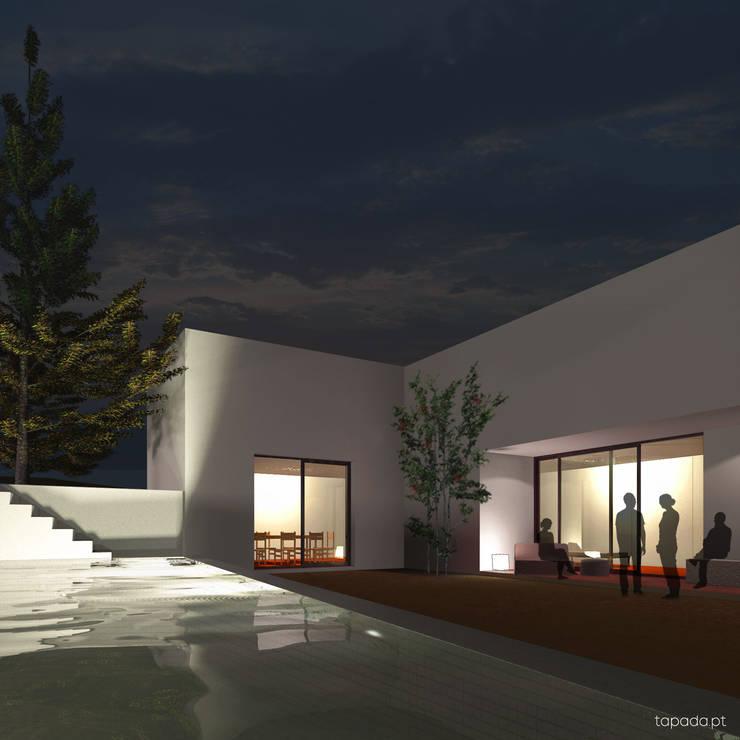 Casa em Cascais: Casas  por Tapada arquitectos