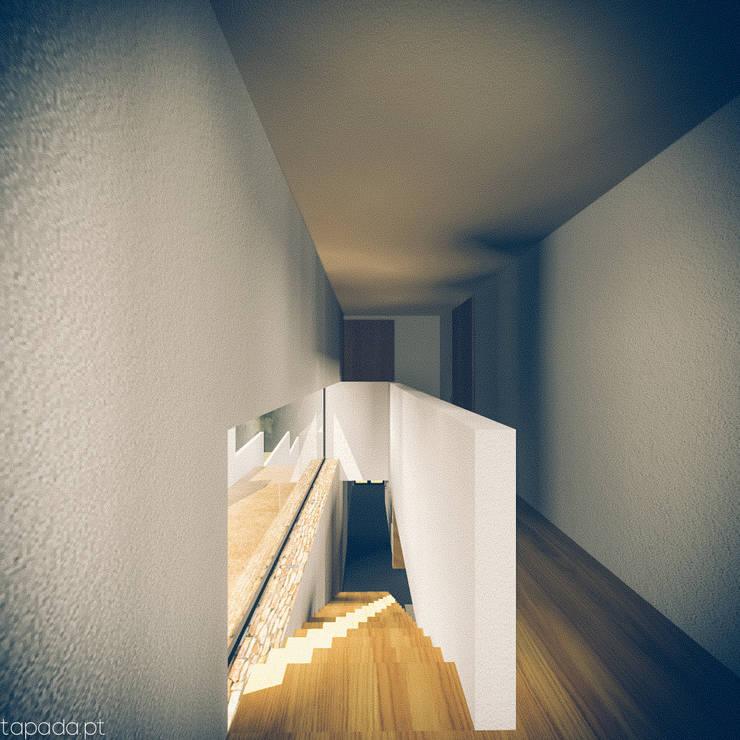 Casa em Barrancos: Corredores e halls de entrada  por Tapada arquitectos