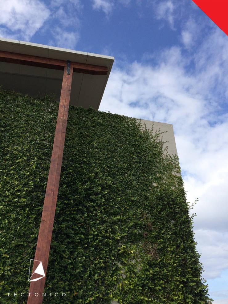 Villa Club de Polo & Ski El Marques: Casas de estilo  por Tectónico