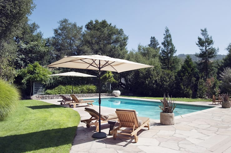 eclectic Pool by Antonio Martins Interior Design Inc