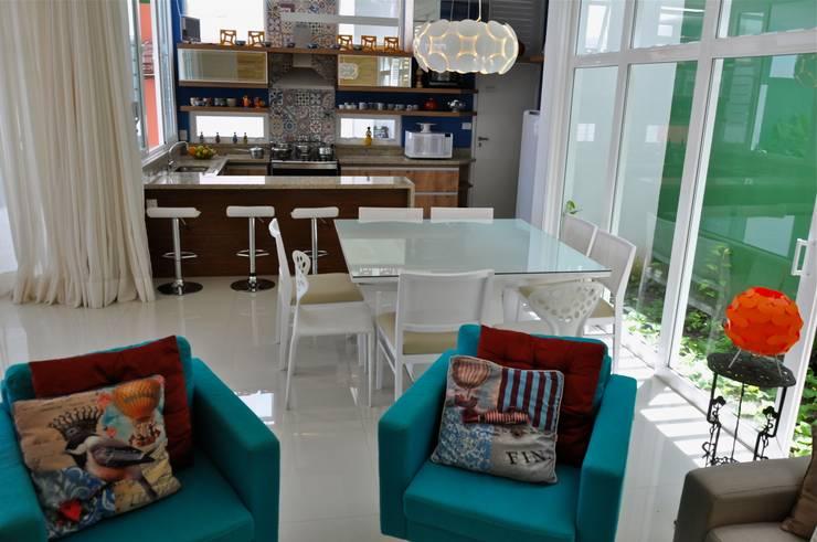 Integração total: Salas de jantar  por Libório Gândara Ateliê de Arquitetura,Moderno