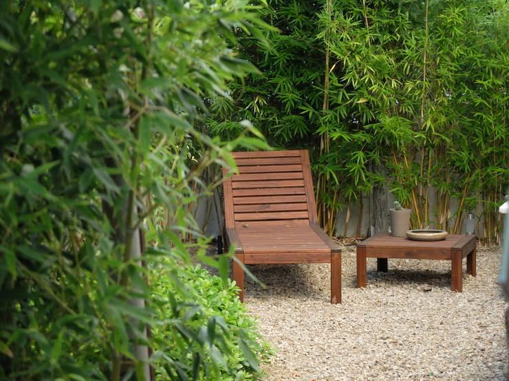 Pormenor de zona de estadia: Jardins  por Atelier Jardins do Sul