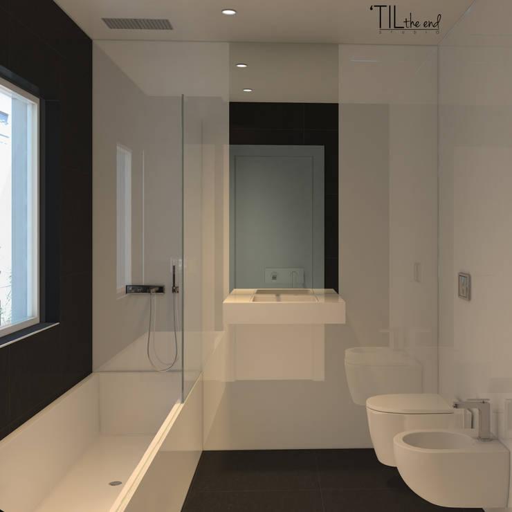 Residential Building in Lisbon: Casas de banho  por Lagom studio,Moderno Cerâmica
