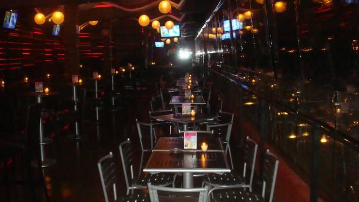 BAREZZITO : Bares y discotecas de estilo  por AQ3 Arquitectos