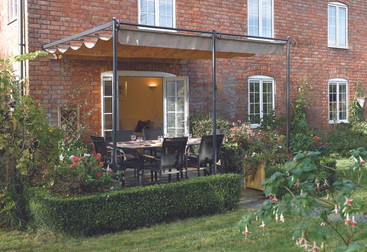 Jardines de estilo  por Heritage Gardens UK Online Garden Centre