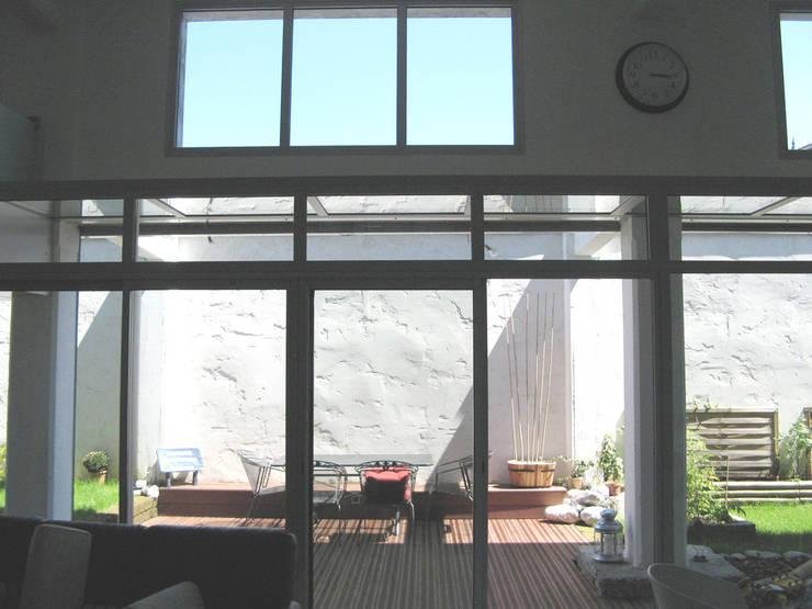 Loft F: Terrasse de style  par FAVRE LIBES Architectes