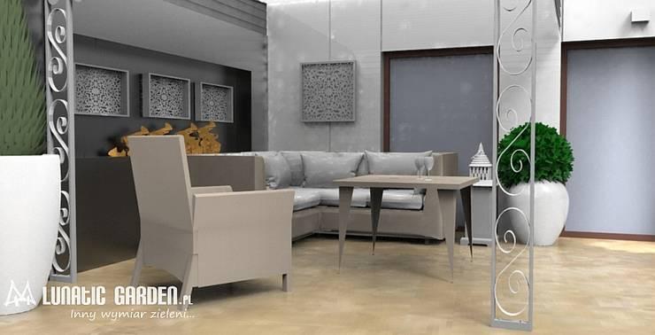 Projekt tarasu: styl , w kategorii Biurowce zaprojektowany przez Lunatic Garden,Klasyczny Kamień
