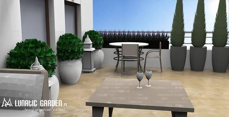 Projekt tarasu w Lublinie: styl , w kategorii Biurowce zaprojektowany przez Lunatic Garden,Klasyczny Kamień