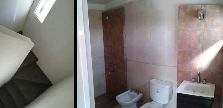 Casa en Funes IV: Baños de estilo  por ELVARQUITECTOS