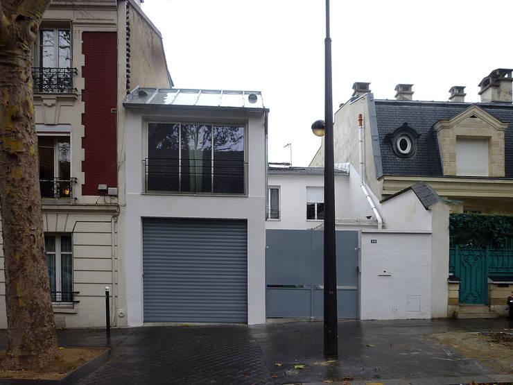 Extensions d'une maison individuelle : Maisons de style de style Moderne par Olivier Stadler Architecte