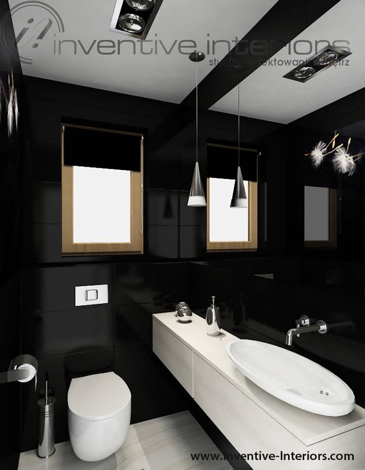 Ciemna mała łazienka: styl , w kategorii Łazienka zaprojektowany przez Inventive Interiors,Nowoczesny