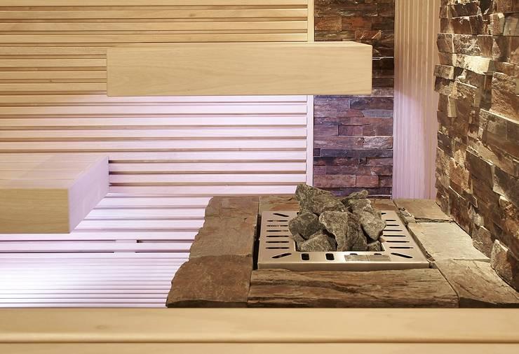 Saunaofen mit Naturstein: modernes Spa von Erdmann Exklusive Saunen