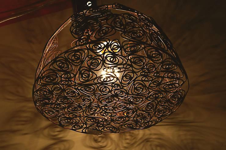 工房dada 照明: 工房dadaが手掛けた寝室です。