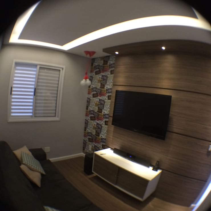 Home theater: Salas multimídia  por Zappa e Oliveira Arquitetura e Interiores