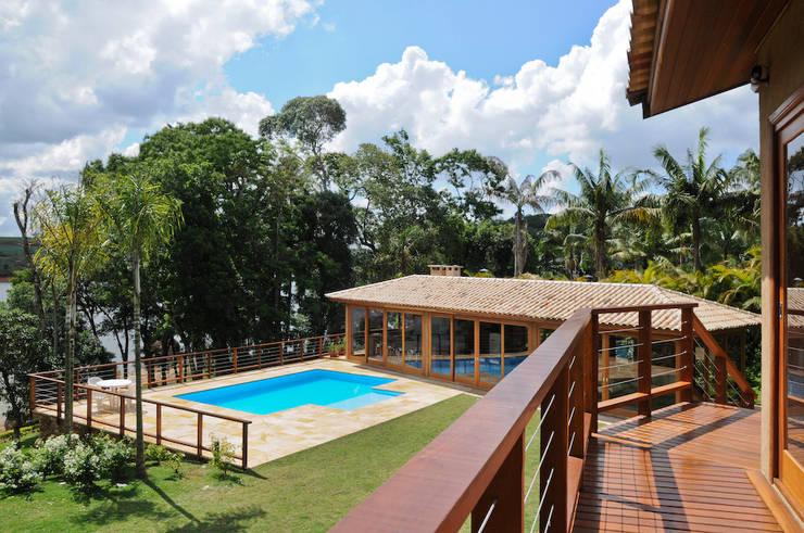 RESIDENCIA CAMPO 1: Terraços  por Martins Valente Arquitetura e Interiores