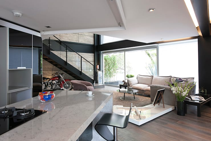 Departamento HG: Salas de estilo  por Hansi Arquitectura