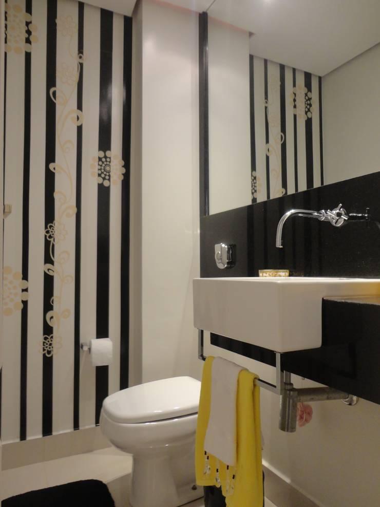 Lavabo: Banheiros  por L N arquitetos