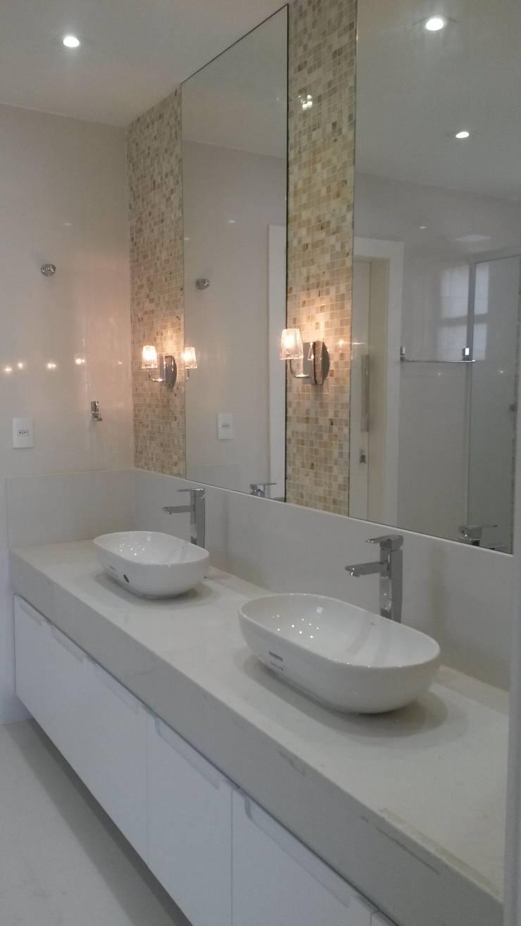 banho suite: Banheiros  por L N arquitetos,