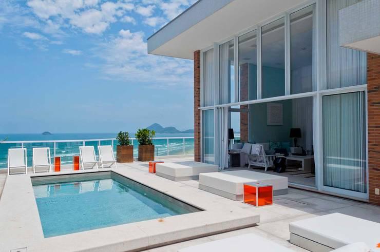 Cobertura Riviera Piscinas modernas por Toninho Noronha Arquitetura Moderno