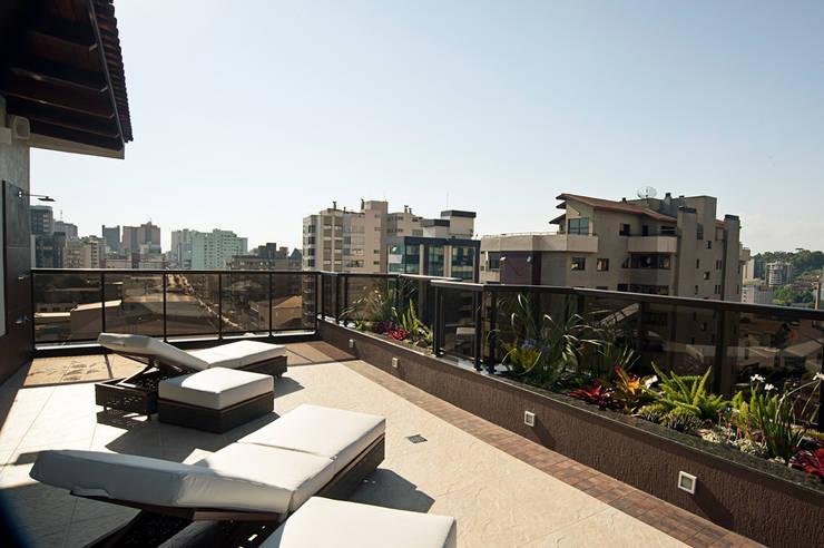 Reforma residencial: Terraços  por Pinheiro Machado Arquitetura,Moderno