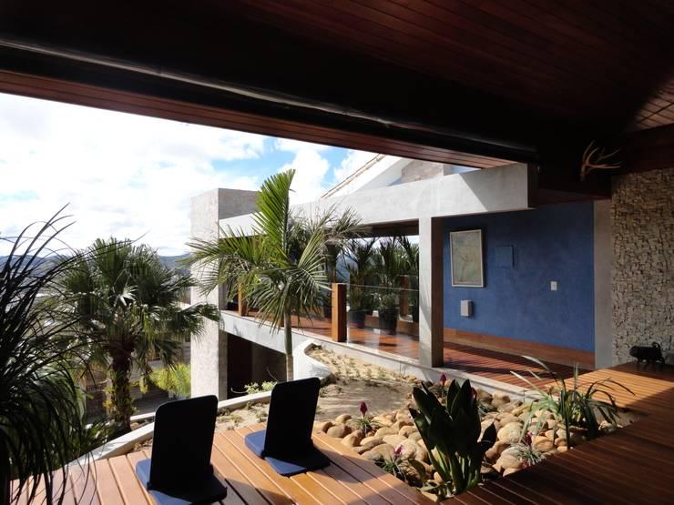 Casa Juiz de Fora – MG: Terraços  por DG Arquitetura + Design