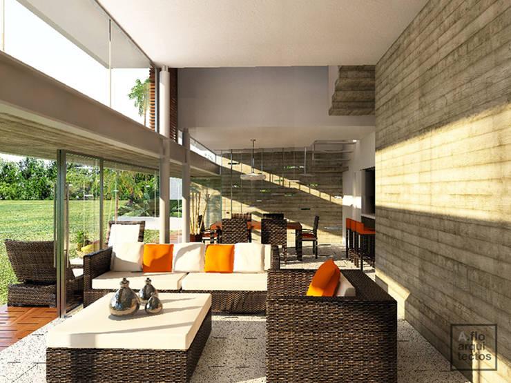 Punta Caracol : Salas de estilo  por A.flo Arquitectos