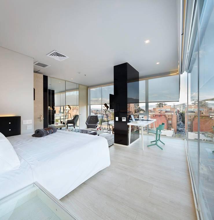 Hotel Click Clack : Hoteles de estilo  por ODA - Oficina de Diseño y Arquitectura,