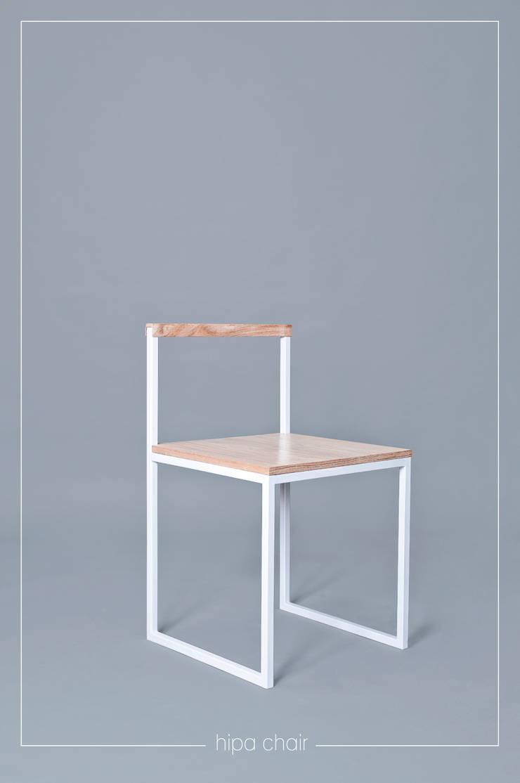 Silla Hipa: Hogar de estilo  por Taller Posible