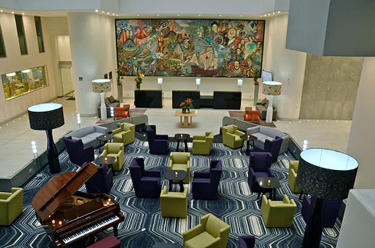 Recepción: Hoteles de estilo  por Factor Metro Cúbico