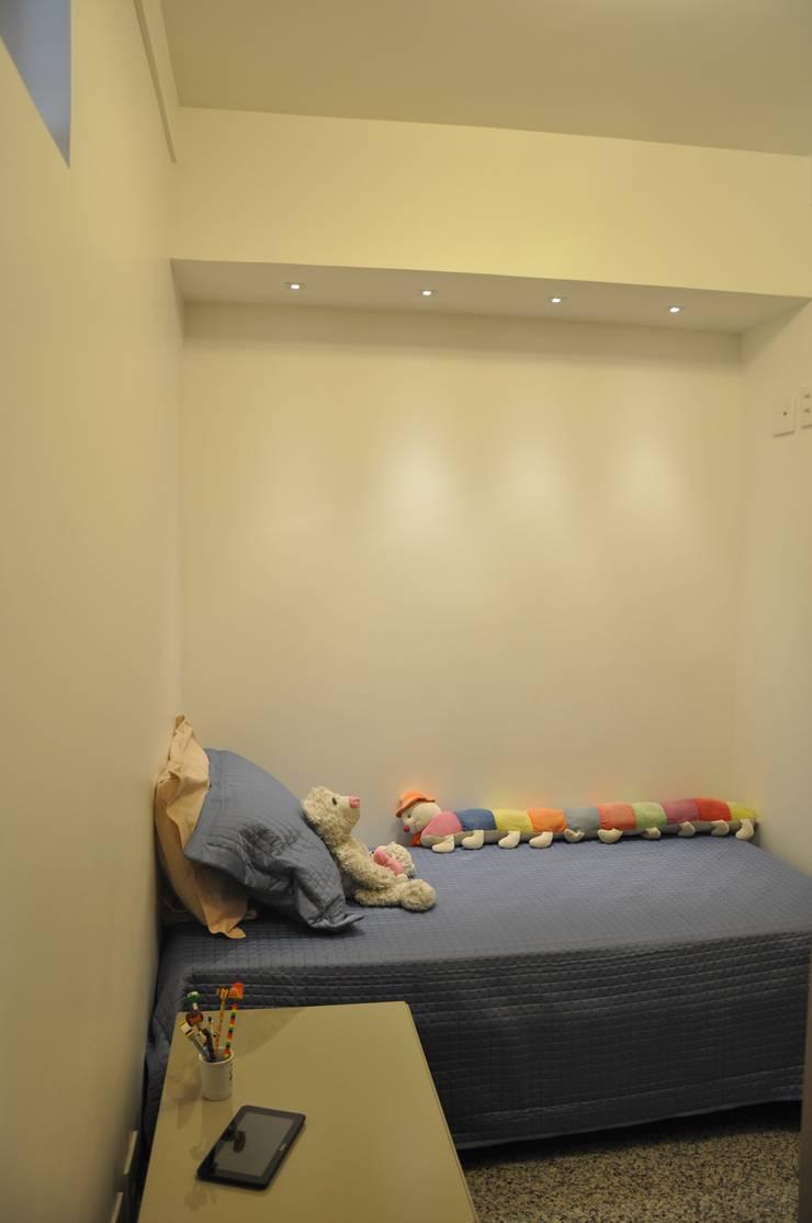 Suite junior: Quartos  por Novità - Reformas e Soluções em Ambientes,