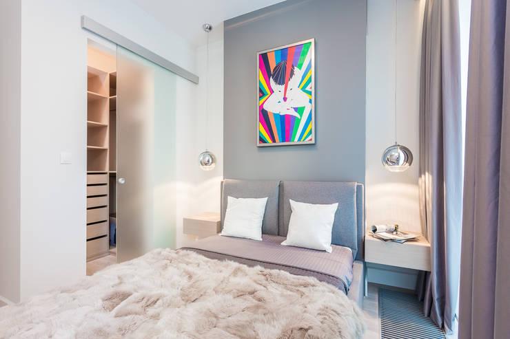 Apartament w Warszawie: styl , w kategorii Sypialnia zaprojektowany przez Michał Młynarczyk Fotograf Wnętrz,