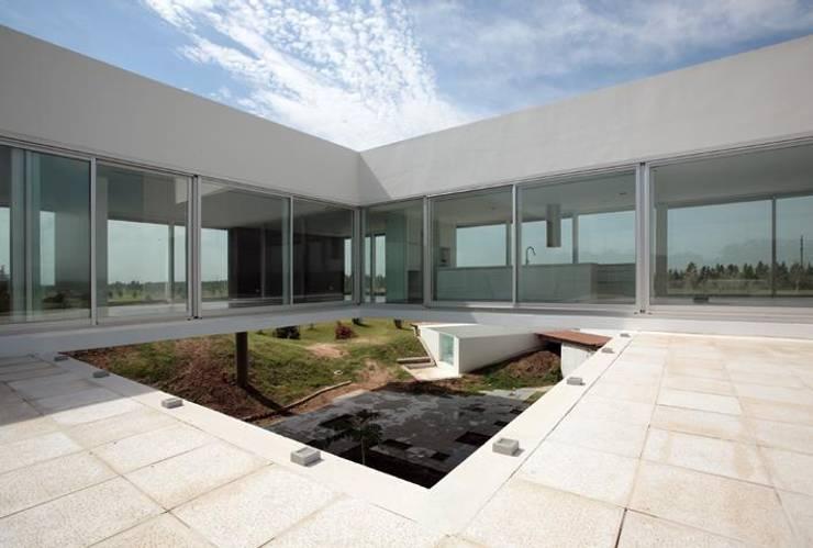 Proyecto Minimalista Casas minimalistas de Estudio Arquitecta Mariel Suarez Minimalista