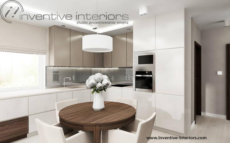 Okrągły stół w aneksie kuchennym: styl , w kategorii Kuchnia zaprojektowany przez Inventive Interiors,Nowoczesny