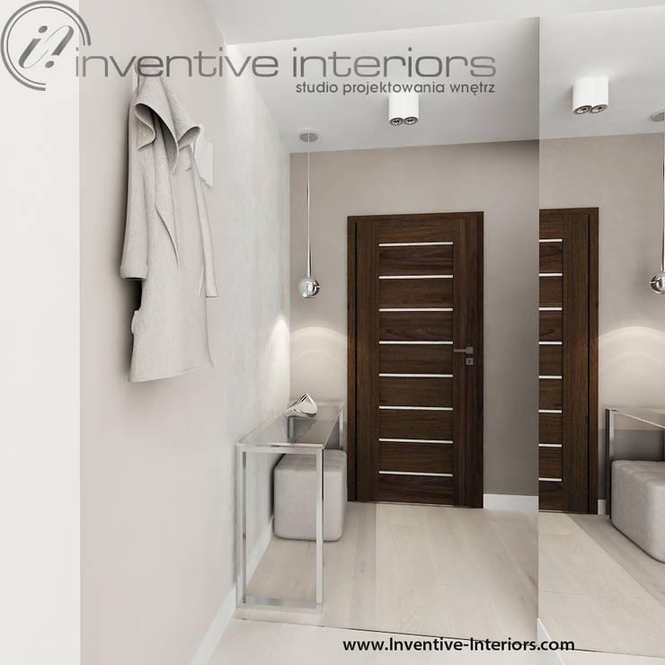 Przytulny elegancki przedpokój: styl , w kategorii Korytarz, przedpokój zaprojektowany przez Inventive Interiors,Nowoczesny