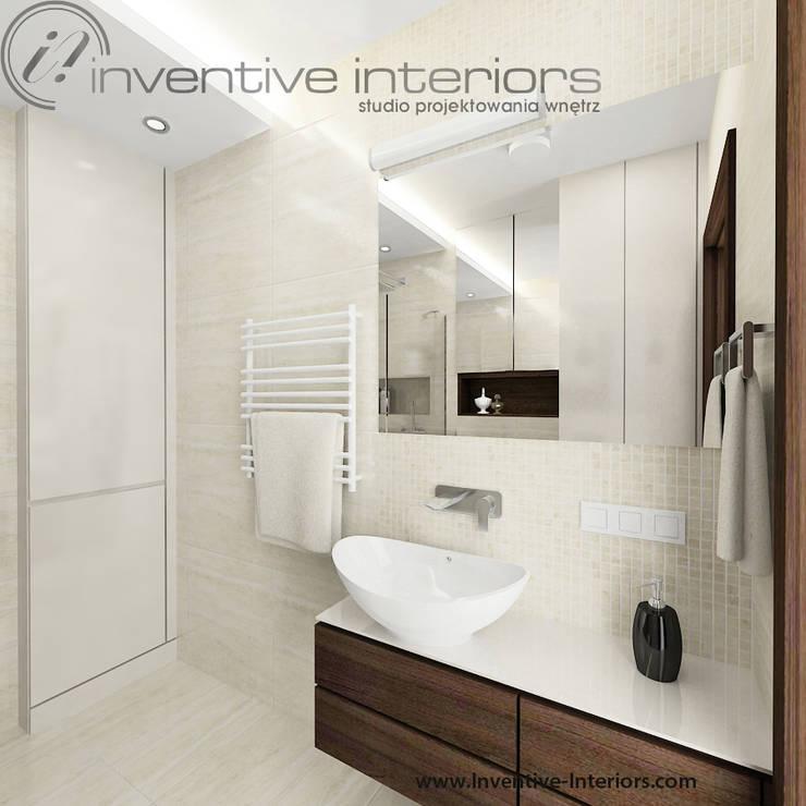 Kremowe płytki w łazience: styl , w kategorii Łazienka zaprojektowany przez Inventive Interiors,Nowoczesny