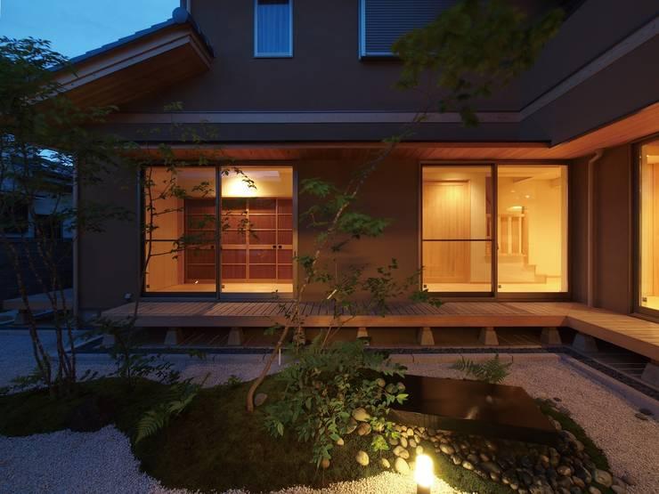 自然の息吹を感じる家: 株式会社蔵持ハウジングが手掛けた庭です。,