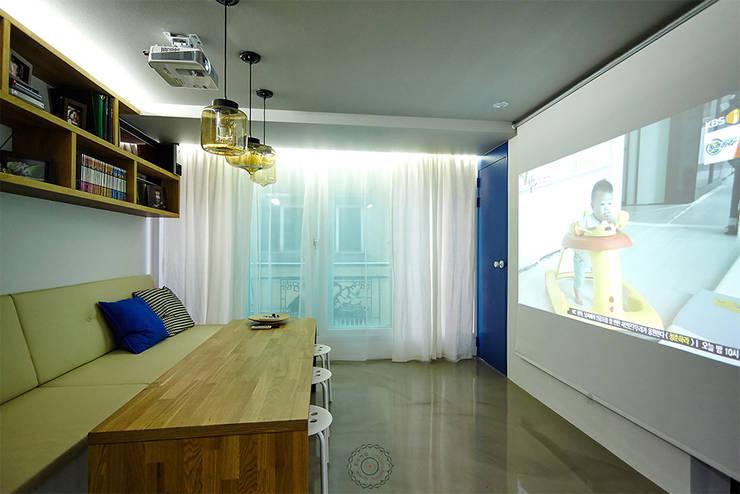 거실: 제이앤예림design의  서재 & 사무실