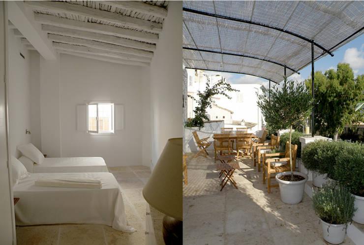 Casa Dalt Vila: Casas de estilo  de r.ex construcciones y reformas integrales sl