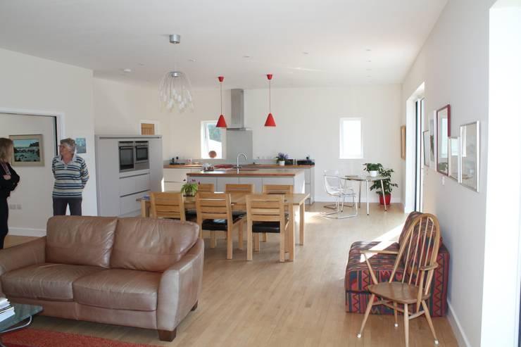 Main House through Living/Dining/Kitchen space: modern Kitchen by Rovano Architecture & Design Ltd