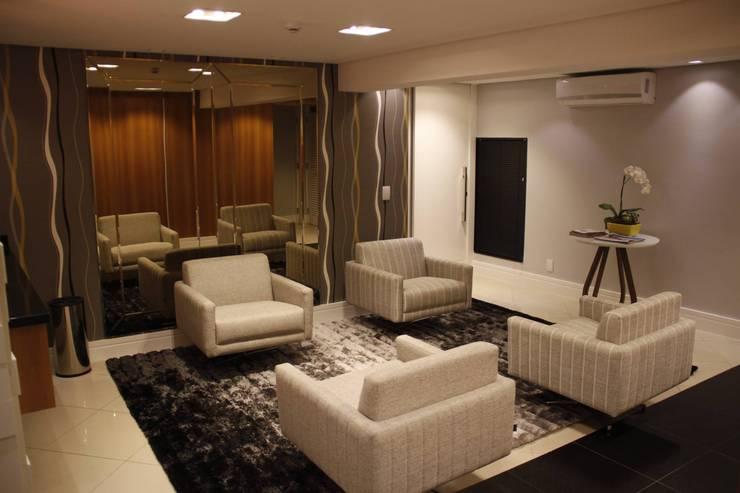 Lounge Hotel Executivo: Hotéis  por Arquiteta Ive Oliveira ,