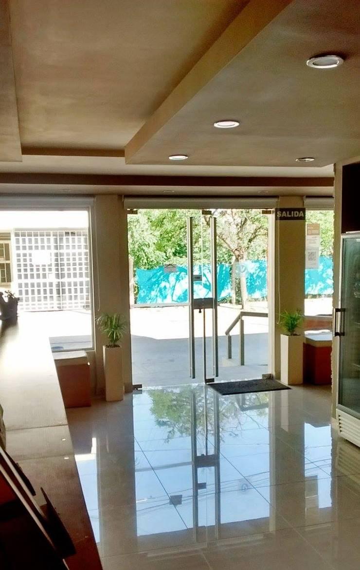Hotel Víctor Remodelado: Hoteles de estilo  por VI Arquitectura & Dis. Interior