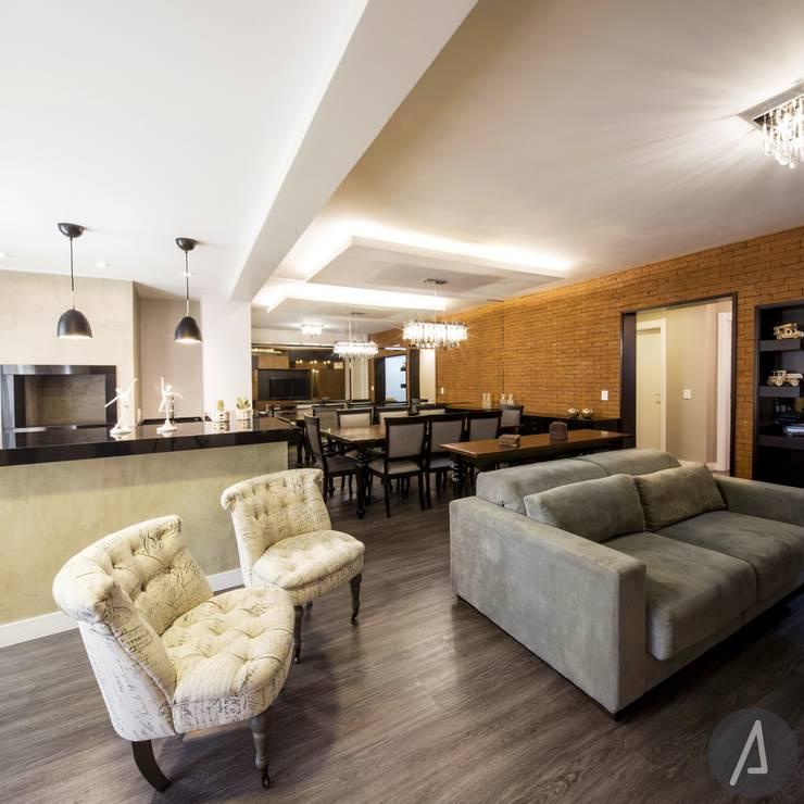 AP 09_Central Parque: Salas de estar  por América Arquitetura,Rústico