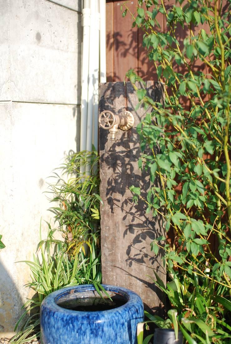 NM House: 株式会社グリーンプラスが手掛けた庭です。