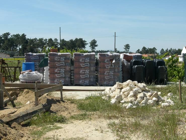 Organização de Estaleiro.: Casas  por knowhowtobuild