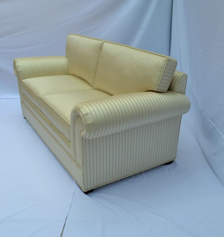love-seat: Salas de estilo  por fabrica de ideas