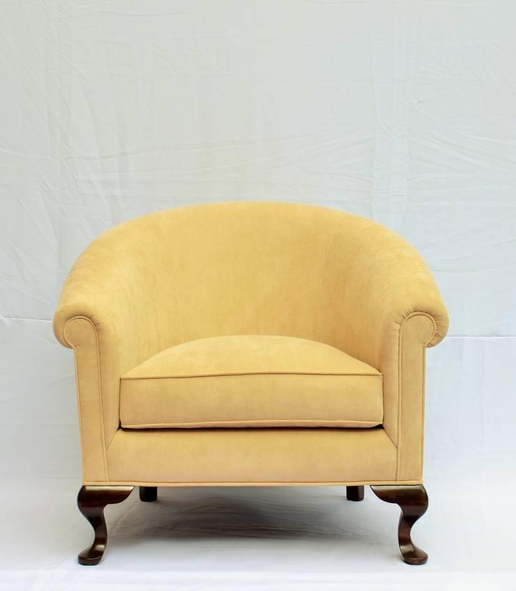 sillón curvo: Salas de estilo  por fabrica de ideas