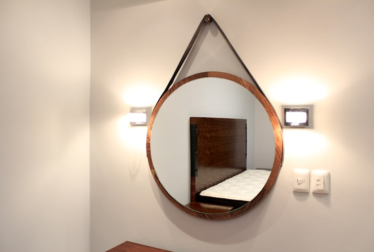 Dormitorios de estilo industrial por D.I. Pilar Román
